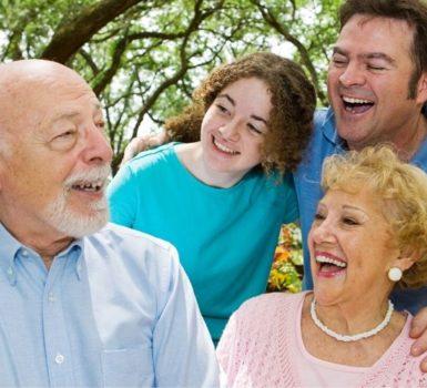Grandad telling the family a joke